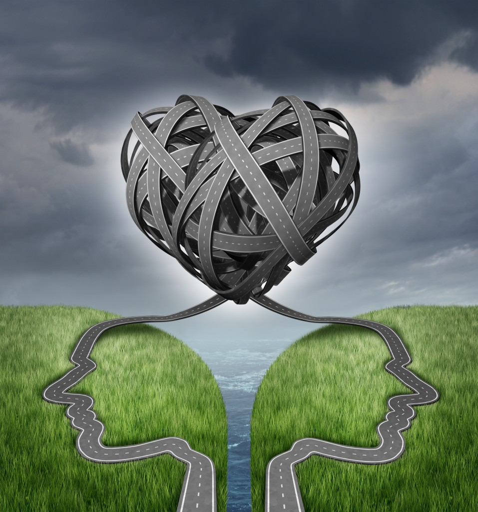 Relationship direction and couple crisis as a social or sexual concept for marriage counseling with a group of two tangled roads or highways shaped as human heads on a cliff in a shape of a heart.
